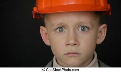 Boy in a construction helmet.Full hd video - Boy builder in...