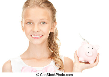lovely teenage girl with piggy bank and money - picture of...