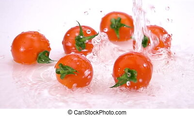 Water Splash on Tomatoes. Slow Motion.