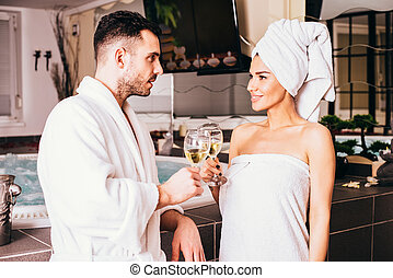 Young loving couple in spa center