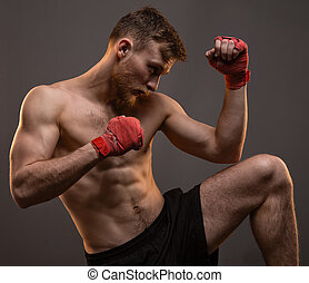Muscular young boxer with leg up - Muscular young man with...