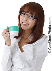 Relaxing business woman with cup of coffee, closeup portrait...