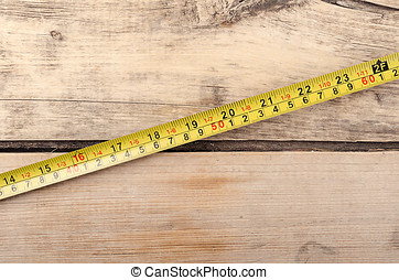 Tools. Tape measurer on wooden background. Ready for work. -...