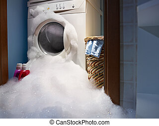 home disasters - soap coming out from broken washing machine...
