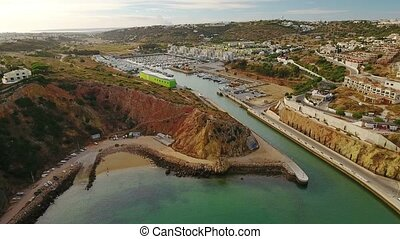 Aerial. Flight towards the marina of Albufeira, to the...
