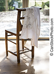 White Embroidered Cloth Hanging on a Wooden Chair Backrest -...