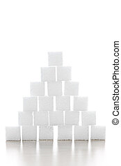 Sugar cube pyramid - Pyramid of white sugar cubes stacked up...