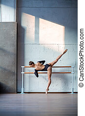 Young beautiful ballerina posing in studio - Young beautiful...