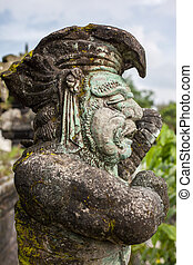 Stone sculpture on entrance door of the Temple in Bali...