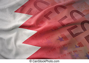 colorful waving national flag of bahrain on a euro money banknotes background. finance concept