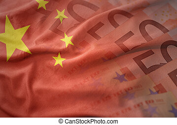 colorful waving national flag of china on a euro money banknotes background. finance concept