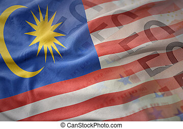 colorful waving national flag of malaysia on a euro money banknotes background. finance concept