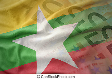 colorful waving national flag of myanmar on a euro money banknotes background. finance concept