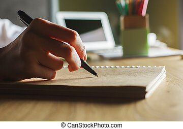 Hand sketching in notepad - Close up of hand sketching in...