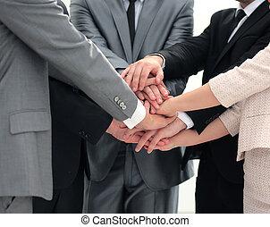 success concept collaboration: a friendly business team put...