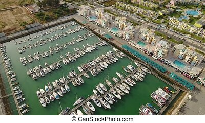 Aerial. Yachts and hotels in marina of Albufeira, top view....