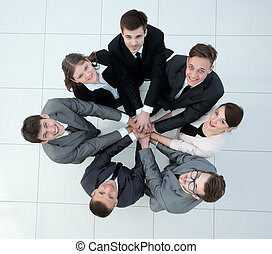 concept of the team standing in a circle of friendly...