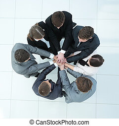 concept of the team .standing in a circle of friendly...