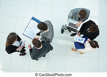 business team with financial schedules,documents and laptop in t