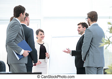 company's management is discussing with the business team,...