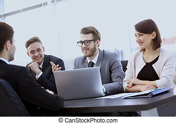 accountant and team members to discuss new financial charts...
