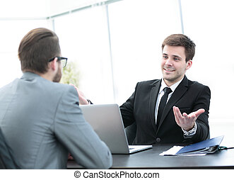 commercial Director discusses current issues with employee...