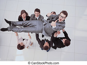 concept of celebrating success.happy business team smiling,...
