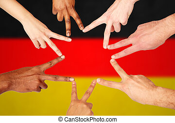 group of international people showing peace sign