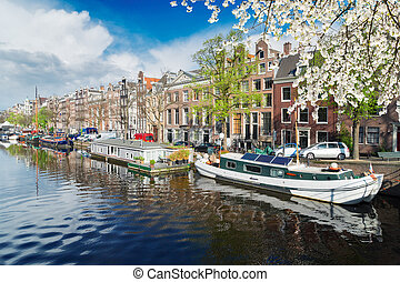Amstel canal, Amsterdam - embankment of Amstel canal in...