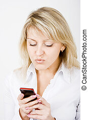 girl with a mobile phone - portrait of blonde girl with a...