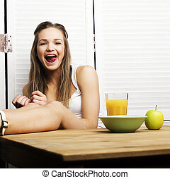 portrait of happy cute girl with breakfast, green apple and...
