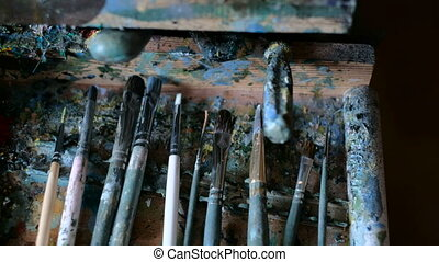 Paints and brushes Brushes and paints of the artist -...