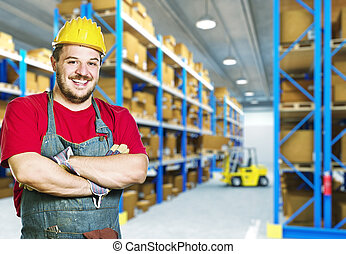 smiling worker in warehouse - smiling caucasian young manual...