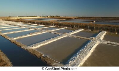 Aerial. The process of salt harvesting on the lakes in Tavira.