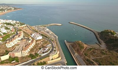 Aerial. Flight over the harbor of the marina of Albufeira....