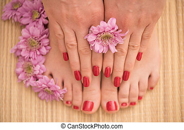 female feet and hands at spa salon - Closeup photo of a...