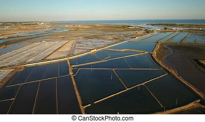 Aerial. View of salt lakes and Quatro aguas in Tavira. Ria...