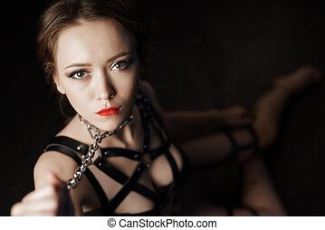 Dominatrix woman in bdsm fetish lingerie - Low key portrait...