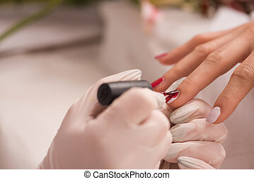 Woman hands receiving a manicure