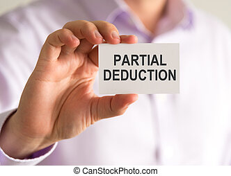 Businessman holding a card with PARTIAL DEDUCTION message