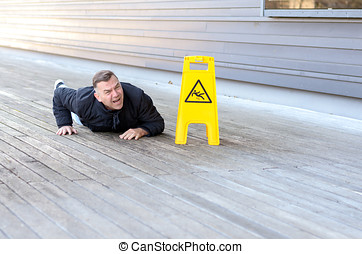 Middle-aged man taken a fall on a slippery floor