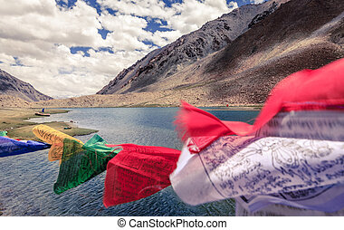 Kashmir Himalayas - Buddhist flags waving in the wind over a...