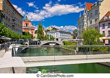 Ljubljana city center on green river Ljubljanica, capital of...