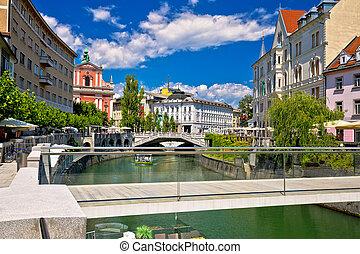 Ljubljana city center on green river Ljubljanica, capital of...