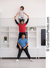 young boys posing line up piggyback - happy young boys...