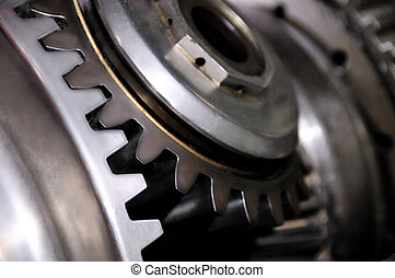 Part of an engine, industrial background - Two gears...