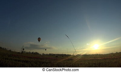 Colorful hot air balloon is flying at sunrise.
