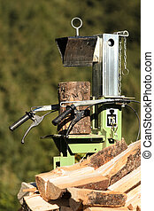 Log splitter - Electric log splitter with wood and trunks