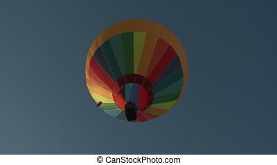View on the colorful hot air balloon from above.