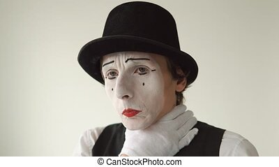 man mime sick. He has a sore throat, cough, colds. Closeup on white background